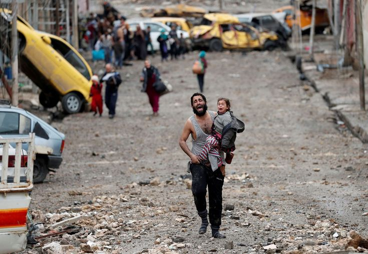 Pictures of Iraq: Photojournalists bear witness to horror in ISIS-occupied Mosul