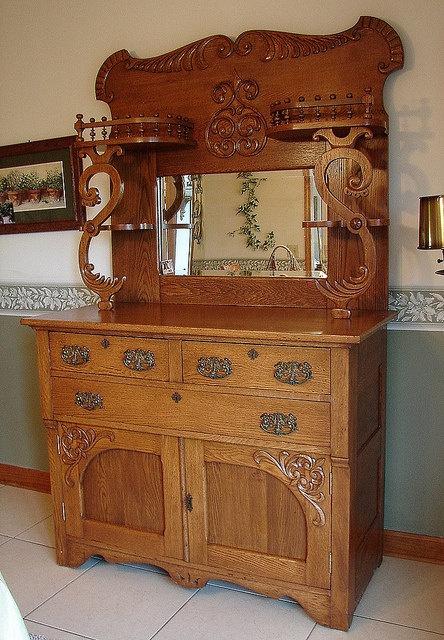 Antique 1920's Vintage Oak Serpentine Tierd Victorian Server Buffet China Cabinet Cupboard w Mirror. $995.00, via Etsy.