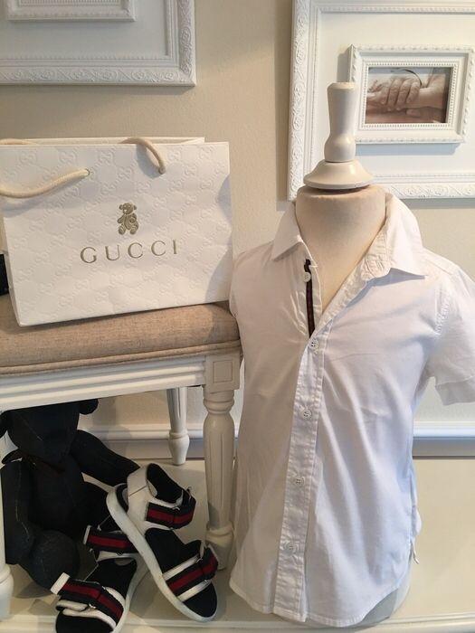 Mein Orig. Gucci Hemd Gr.36 Monate / 98 cm von GUCCI! Größe 98 für 49,00 €. Schau´s dir an: http://www.mamikreisel.de/kleidung-fur-jungs/kurzarm-hemden/33251667-orig-gucci-hemd-gr36-monate-98-cm.