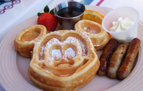 Mickey Mouse waffle with sausage breakfast.
