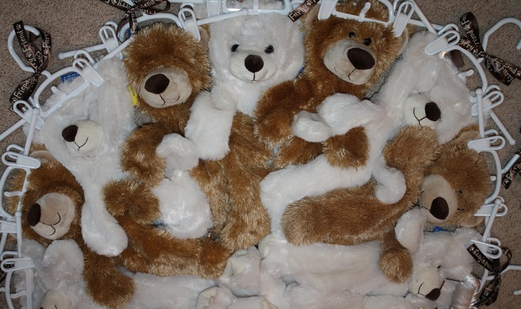 Build-A-Bears  - Unstuffed Bears purchased to enclose inside of a Build-A-Bear party invitation.  Boys received the brown.  Girls received the ivory.