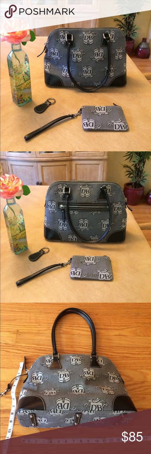 """👛 Dooney & Bourke; Lg. Doctor's Bag Purse Newish! Barely used! Dooney & Bourke, Black & Gray Doctor Bag Style Signature Fabric w/Leather Purse! Includes a Zippered Pouch with Key Ring (4""""x 6""""), & another Key Chain for your House/Car Keys. See inside label in photo for Authenticity. This Bag is Large! Measurements are approx. 14 1/2"""" across, Height is approx. 10"""" + another 9"""" to the top of the handle. Width is approx. 5"""" at the largest part, however, this bag is very stuffable! Can carry…"""