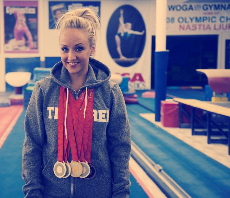 2008 Olympic Gymnastic CHAMPION. ALL AROUND GOLD Medalist, Silver on BB and UB, Bronze FX . Nastia Liukin. Beijing.