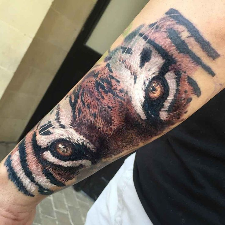Tiger eyes tattoos lower back - photo#18