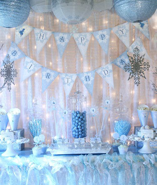 WW: I like the material used as a table skirt, and I like the Christmas lights.-Frozen Birthday Party Ideas