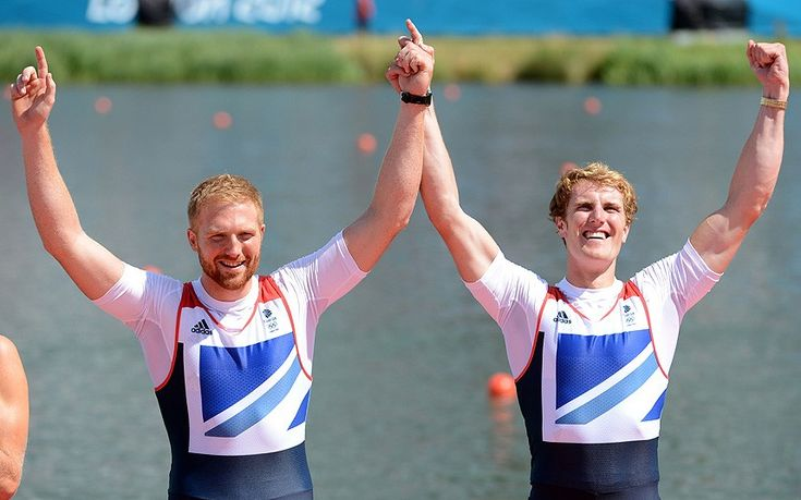 William Satch and George Nash of Great Britain celebrate before receiving their bronze medals during the medal ceremony for the Men's Pair final on Day 7 of the London 2012 Olympic Games