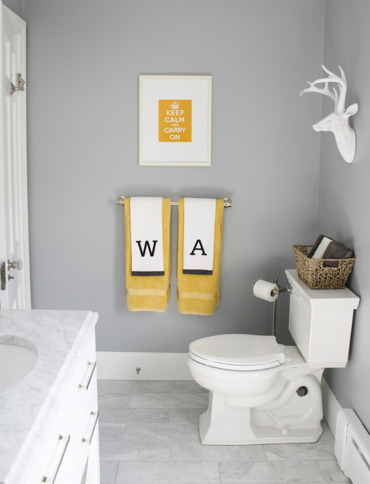 Frame, Towels, and a basket. Complements each other to make a bright space.