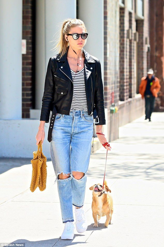 Carefree! Martha Hunt, 27, looked relaxed as she went on a walk through the West Village neighborhood of New York City on Thursday with her dog, Bear