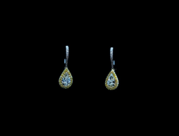 PEAR SHAPE DIAMONDS EARRINGS WITH FANCY INTENSE YELLOW ROUND BRILLIANT CUT    COLUCCI DIAMONDS