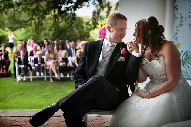 An intimate moment at Lucy & Nathan's outdoor ceremony in Berkshire / nealejames.com