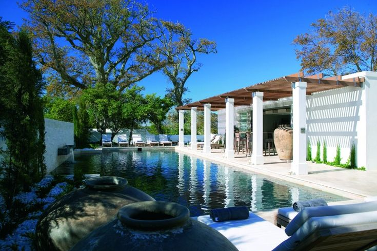 STEENBERG POOL BAR (2006)  Stay at The Steenberg Country Hotel where the new pool and bar areas have undergone a new look under the creative...