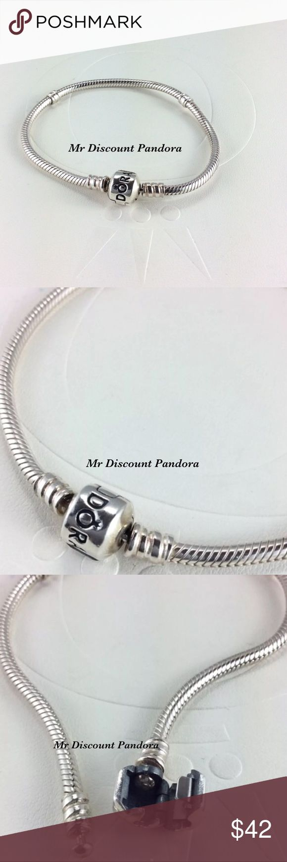 """7.5"""" Pandora Iconic Silver Bracelet This sterling silver charm bracelet is the most popular PANDORA bracelet. Its design features a barrel charm clasp and our innovative threading system, which makes it easy to screw PANDORA charms onto your bracelet and keep them securely where you want them. This is the perfect style to start or add to your charm collection.  Condition: Gently used (Not stiff)  Retail new $70.00 including taxes  Add a Pandora box for $4 more  Bundle/Offer for discount…"""