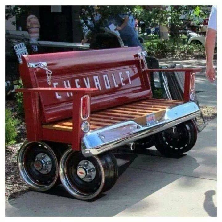 A very unique bench made from wheel rims, tailgate, and truck bed! I think it may need a cushion on the seat ... looks a bit uncomfortable
