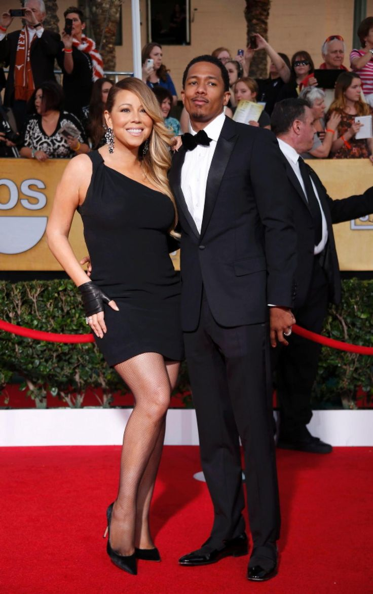 Mariah Carey's fishnet tights and leather fingerless gloves made her look like she got lost on her way to a mid-80's Madonna concert. Nick Cannon opted for a more classic red carpet look in a simple tux.