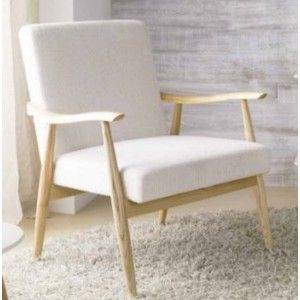 Lenestol i skandinavisk design med sete og rygg i naturhvitt stoff. Ben i naturlig tre(ask) . $8,625.00