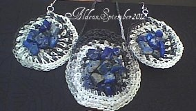 Sodalit set on a black and white string. A necklace,in the middle and earrings