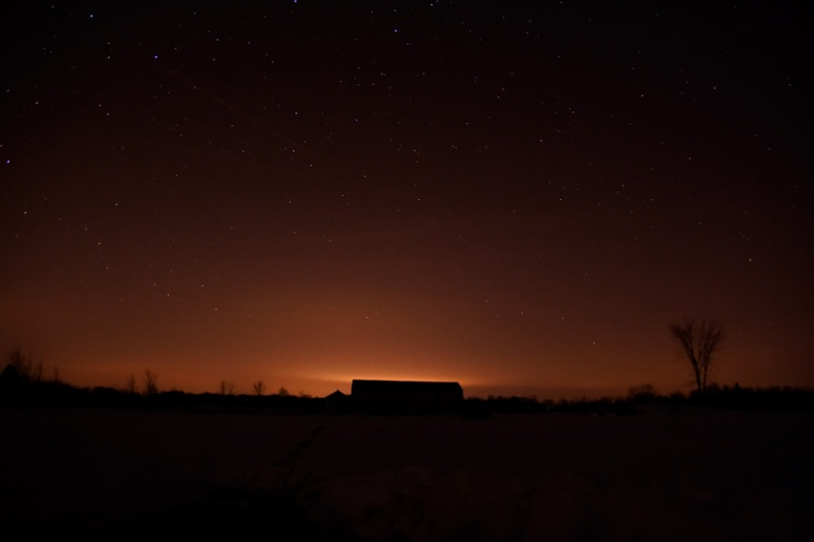Light pollution. The artificial light dome being cast into the night sky by the city of Stratford, Ontario due to excessive exterior lighting that is not directed down to the ground.