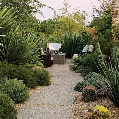 Desert garden path    Bold furnishings and dense plantings can help you create a getaway in your own backyard, even where gardening can be a challenge.    Individual concrete pads create the illusion that they're hovering lightly above the desert floor. Their exposed aggregate finish blends in with the native soil's stony texture