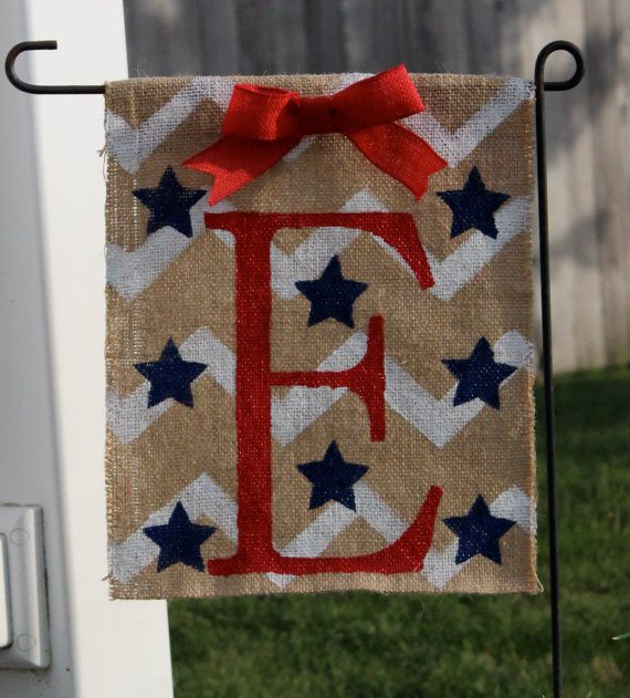 Add a touch of fun to your garden with this patriotic monogramed burlap garden flag. This item is made to order and can be ready to ship to you in just over a week! Please let me know the monogram initial that you would like. The flag is hand painted by me and sealed with a UV resistant clear coat. It measures approximately 16 long by 12 wide, with a 2.5 opening for easy hanging. The burlap edges are sewn together to prevent fraying. Custom orders accepted. If youd like a custom flag just…