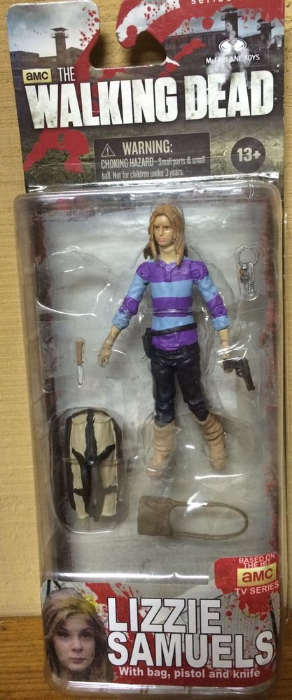 """This is a custom action figure of Lizzie Samuels played by Brighton Shabrino from the T.V. Series """"The Walking Dead"""", as she appears in the season four - """"The Groove"""". Description from ebay.com. I searched for this on bing.com/images"""