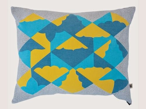 Limited edition textiles by Kangan Arora for Heal's. Kites Blue & Yellow Cushion by Kangan Arora. Image courtesy of Heal's.
