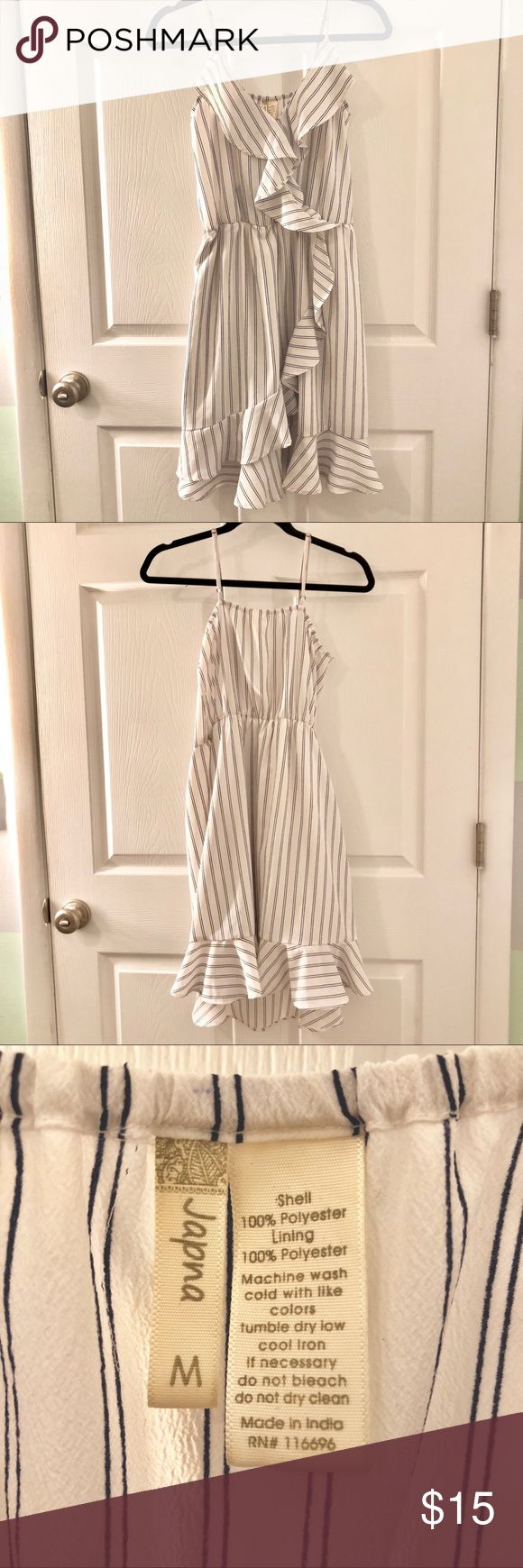 White & Navy striped dress Dress in white with navy stripes and adorable ruffle details throughout. Used only once. Classic dress. ✨Bundles of 3+ items get 15% off! Japna Dresses