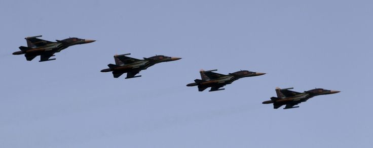 Russian Air Force Su-34 fighter-bombers take part in a military parade during celebrations marking Independence Day in Minsk