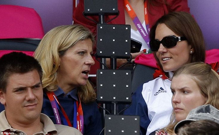 The Duchess of Cambridge speaks with former Olympic champion Sally Gunnell while watching athletics. She was wearing a patriotic Team GB jacket with her favourite Givenchy sunglasses
