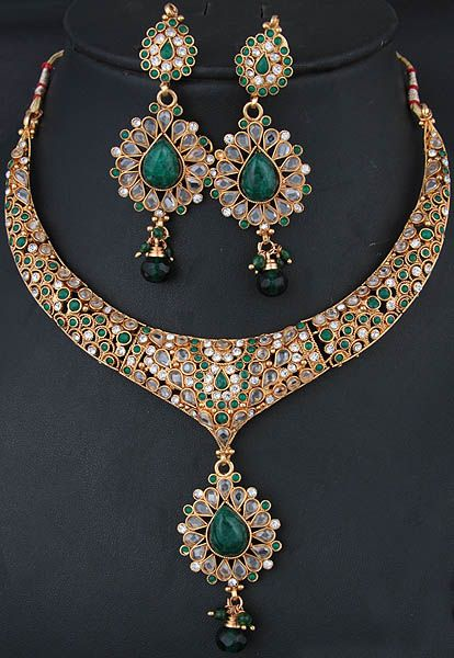 https://www.bkgjewelry.com/sapphire-ring/313-18k-yellow-gold-diamond-blue-sapphire-ring.html Green Polki Necklace and Earrings Set with Faux Emerald