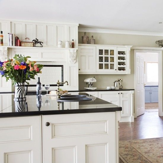 White cabinets, black granite with color similar to agreeable gray?