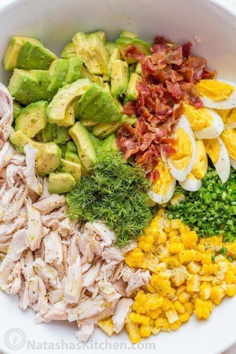 This Avocado Chicken Salad recipe is a keeper! Easy, excellent chicken salad with lemon dressing, plenty of avocado, irresistible bites of bacon and corn | natashaskitchen.com #natashaskitchen #salad #chicken #avocado