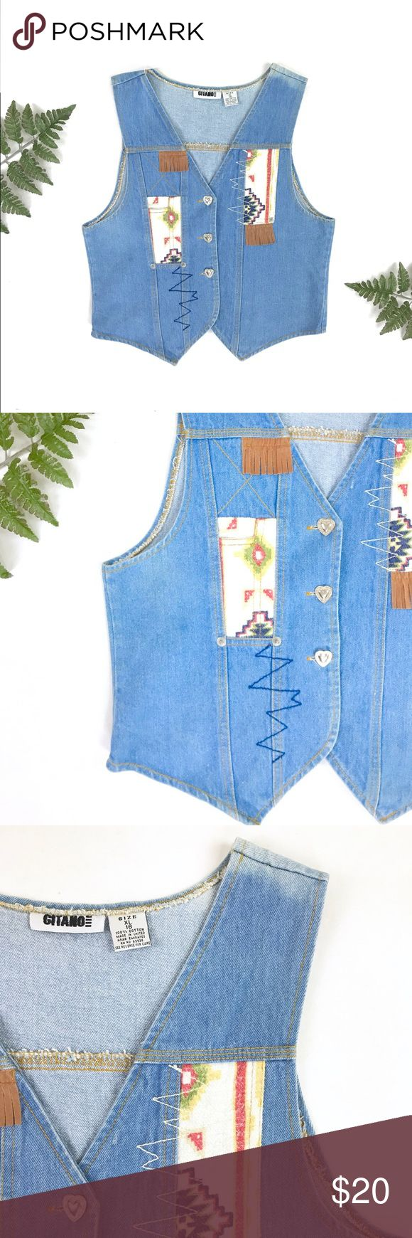 """90s does 70s southwestern style denim vest VTG sweet little 90s does 70s denim vest featuring light wash denim, flannel southwestern style patches and fringe, zig zag stitching, and three heart buttons. teens size 16 but can fit a women's S/M, see measurements. there is a faded spot on the left shoulder, otherwise like new vintage condition  LABEL: brand - Gitano size listed - 16 XL made in USA  MEASUREMENTS: laying flat 22"""" long 18"""" bust 10.25"""" arm opening Levi's Jackets & Coats Vests"""