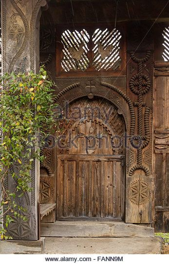 Beautiful traditional hand made door from the entrance in a Romanian household - Stock Photo