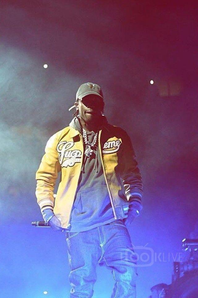 Travis Scott wearing  Fan Merchandise Travis Scott Anti Tour Cap, Supreme Uptown Studded Leather Varsity Jacket, Vans   Old Skool Lite
