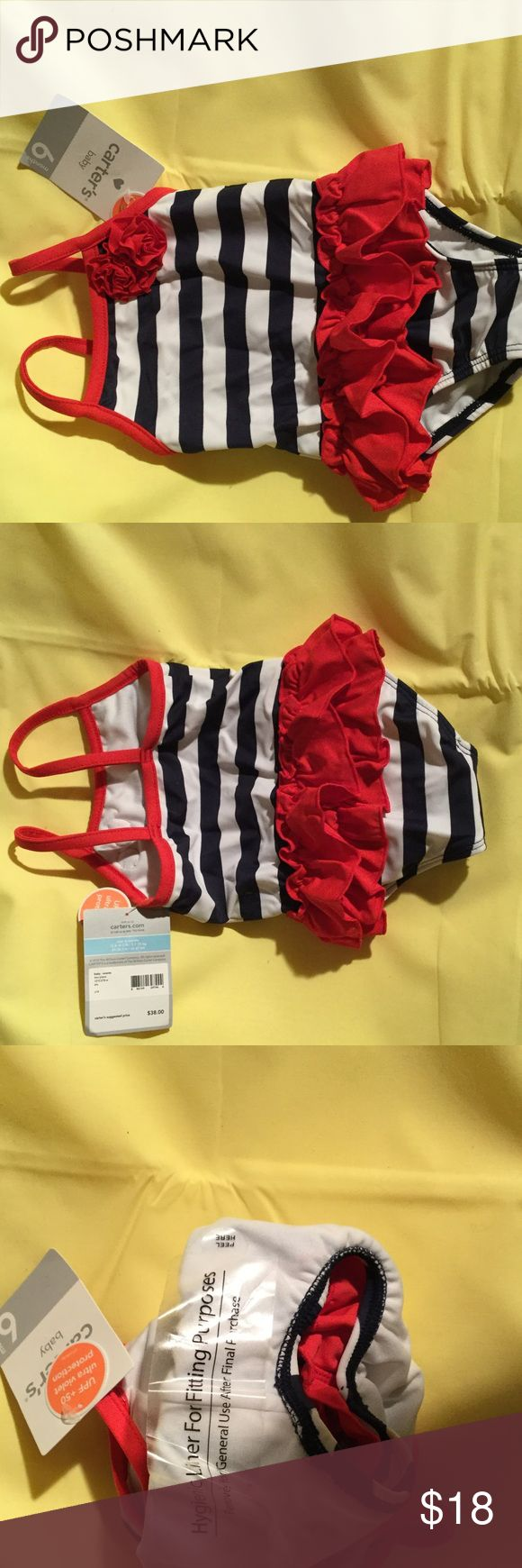 Baby girl red white blue one piece swimsuit 6m NWT Carters baby girl. Swimsuit in a blue and white strip with red waistline ruffles and a flower embellishment. Super cute with UPF 50 sun protection and NWT. 6m size carters Swim One Piece