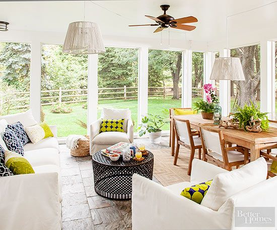 Why stick to one function when there's room for two? This spacious sunporch boasts a seating group for lounging and a dining area for meals, games, and more. Secret to Pretty: Promoting unity. If your porch is spacious and supports several functions, look for ways to unify the space. White upholstery on the dining chairs matches the sofa and chairs. Matching light fixtures above the seating group and the dining table creates cohesion.