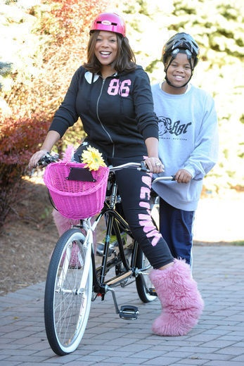 Wendy Williams and son - i think lil kev has his helmet on backwards