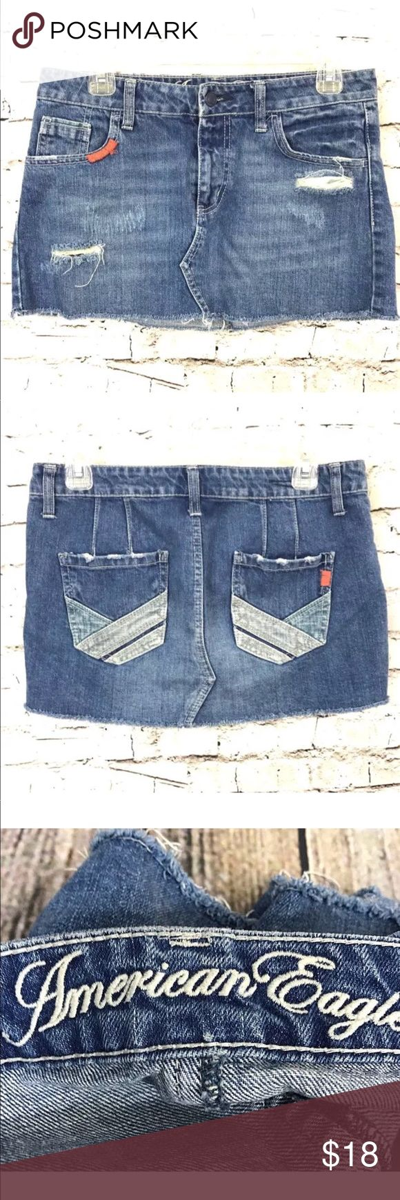 """{American Eagle} Mini Skirt Destroyed Denim Size 6 American Eagle Jean Skirt  Women's Size 6 100% Cotton Denim Distressed / destroyed denim Zip fly / button closure 5 pocket style Above knee mini length Waist = 30"""" Length = 11.5 Pre-owned condition without flaws   Thank You For Your Business! American Eagle Outfitters Skirts Mini"""