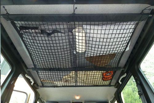 Creative rv storage idea ceiling cargo net above kids for Comforter storage ideas