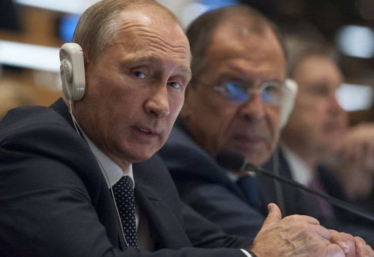 Vladimir Putin (left), President of the Russian Federation, listens to a speaker during the general debate of the General Assembly's seventieth session. At his side is Sergey V. Lavrov, Minister for Foreign Affairs of the Russian Federation.   UN Photo/Cia Pak 28 September 2015 United Nations, New York Photo # 645487