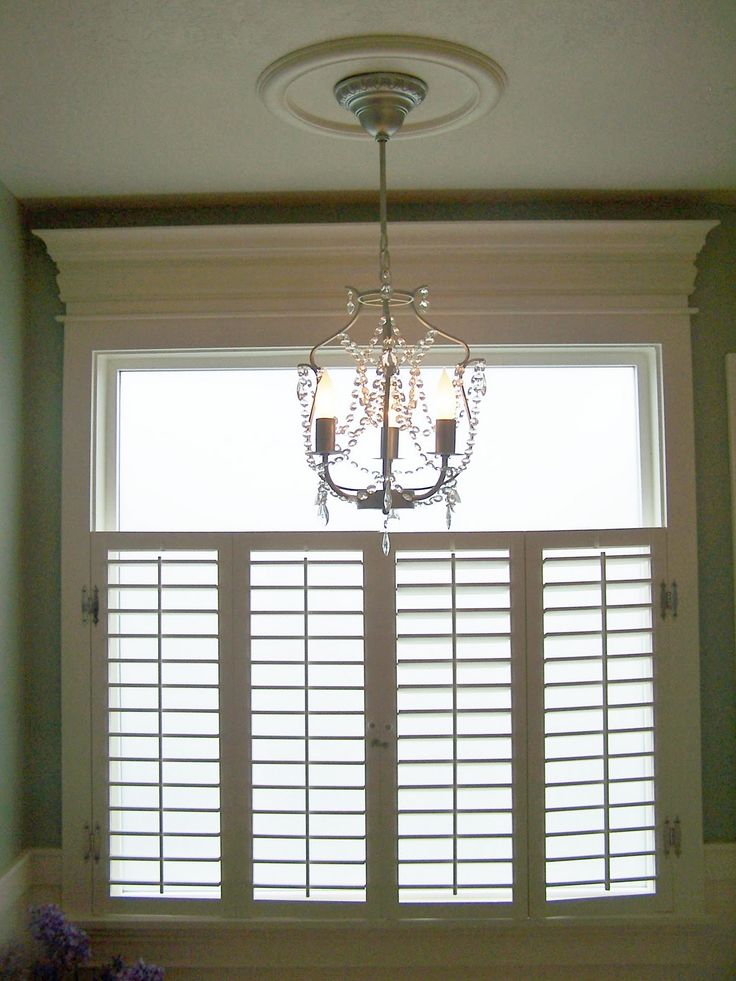 plantation shutter roman shade or valnance with pull down shade for the huge master