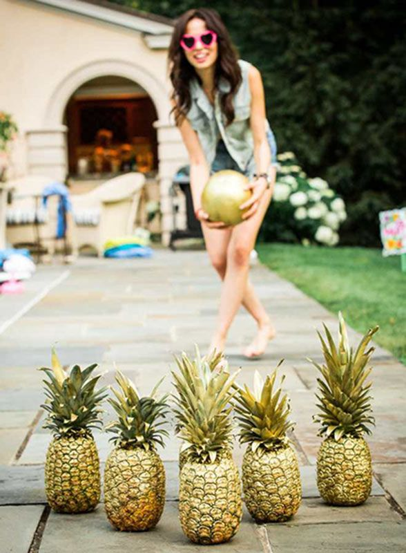 Can a bridal shower get any more fun? From gilded pineapple bowling to summer cocktails poolside, this is the theme of the summer. Photo by Yasmin Sarai Photography