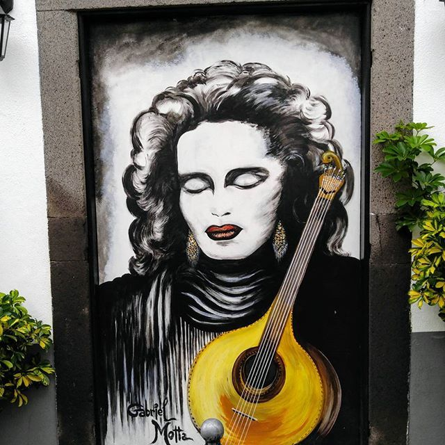 The most famous fado singer of Madeira (unfortunately already died), seen at the Funchal Old Town door.  The whole old town is full of doors turned to be paintings. Very entertaining walk through the old town.  #fado #funchal #madeira #portugal #visitmadeira #art #painting #door #travelblogger #timokiviluoma