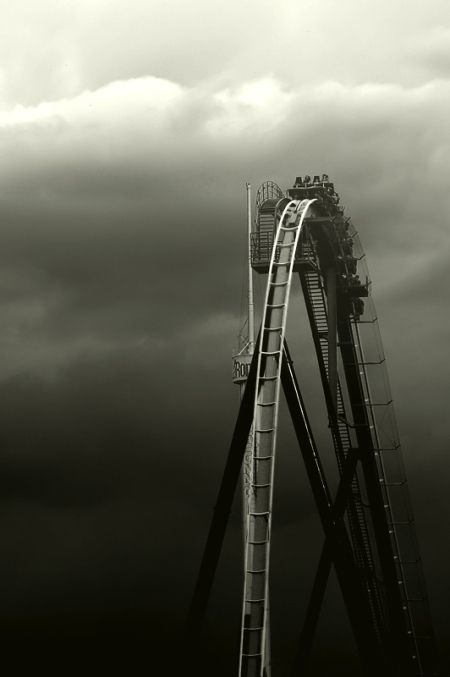 Great monochrome black and white photograph of a roller-coaster in the clouds / unknown photographer #monochrome #roller-coaster #photography