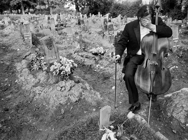 ... down in tears after playing a requiem to a dead friend at Hero's Cemetery, where Bosnian fighters were buried during the siege of Sarajevo in [Credit ...