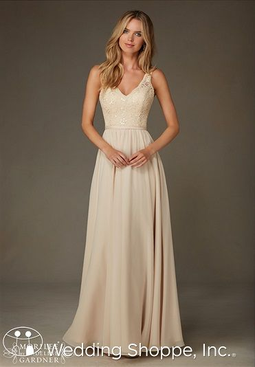 A timeless bridesmaid dress with a lace v-neck bodice and long chiffon shirt. | The Wedding Shoppe: Celebrating 40 Years in the Wedding Industry