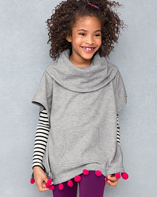 Three cheers for a trendy poncho with playful pom-pom trim. Unique for a poncho style, the unexpectedly ultrasoft sweatshirt material keeps it casual, yet the unique trim and pockets make this a fun and truly unique piece.