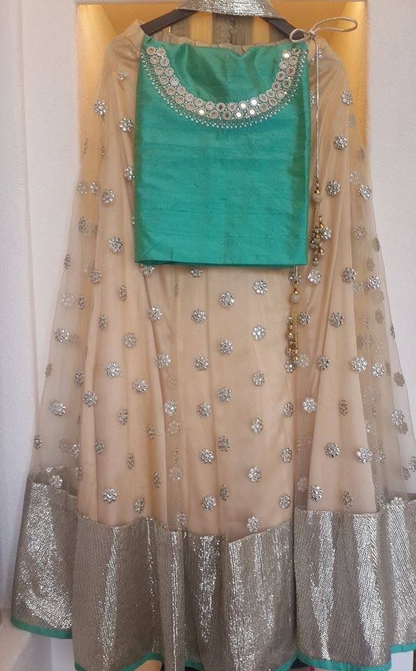 Beige lehenga and mint green blouse
