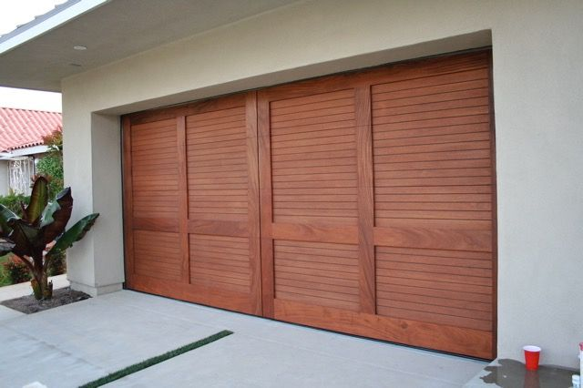 "Riviera to us is "" a way of life"". Riviera garage doors are made from the best hardwoods such as mahogany and teak. The natural beauty of these hardwoods combined with the relaxed Riviera lifestyle gives these garage doors a cutting edge design with a tropical flare."