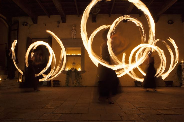 Castello il Palagio. Fire show in the courtyard#AlmaProject www.castelloilpalagio.eu